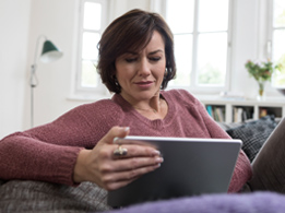 Image of a woman banking on a tablet