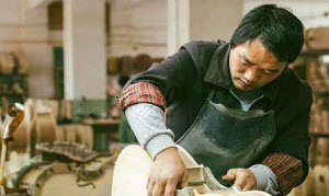 Man making musical instrument